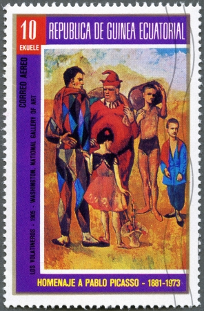 picasso: EQUATORIAL GUINEA - CIRCA 1973  A stamp printed in Equatorial Guinea shows draw by Pablo Picasso - The Family of Saltimbanques  Pink Period paintings , 1905, Oil on canvas, The National Gallery of Art, Washington, DC, USA, circa 1973