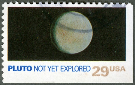 pluto: UNITED STATES OF AMERICA - CIRCA 1991: A stamp printed by USA shows Pluto, not yet explored, Space Exploration Series, circa 1991 Stock Photo