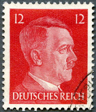 cancelled stamp: GERMAN REICH - CIRCA 1940s: A stamp printed in Germany shows portrait of Adolf Hitler (1889-1945), series, circa 1940s Stock Photo