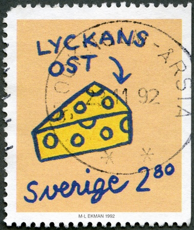 SWEDEN - CIRCA 1992: A stamp printed in Sweden shows Cheese, series Greetings Stamps, circa 1992 photo