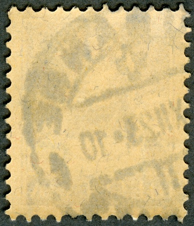 The reverse side of a postage stamp on a black background Stock Photo - 13794047