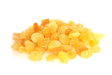 Golden raisins on a white background photo