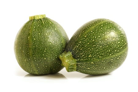 marrow squash: Courgette or zucchini on a white background