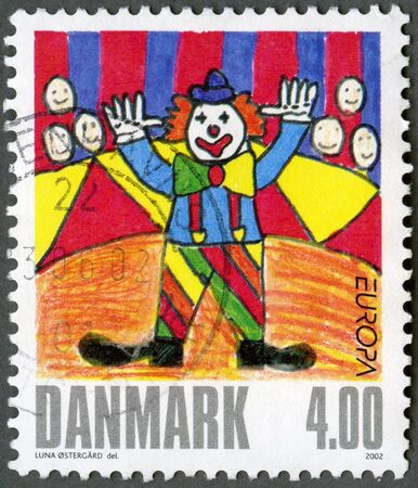 DENMARK - CIRCA 2002  A stamp printed in Denmark shows Clown, by una Ostergard, series Winning drawings in children stamp design contest, circa 2002 Stock Photo - 13970821