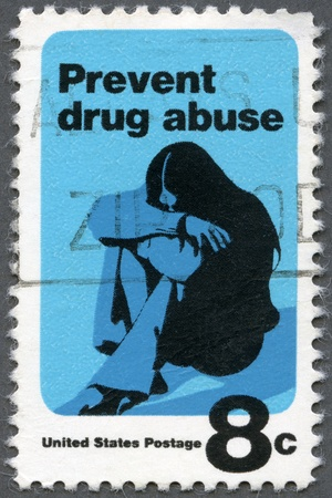 narcotism: USA - CIRCA 1971: A stamp printed in USA shows a Young Woman Drug Addict, Prevent Drug Abuse, Drug Abuse Prevention Week, circa 1971
