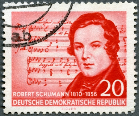 GERMAN DEMOCRATIC REPUBLIC - CIRCA 1956: A stamp printed in GDR shows Robert Schumann (1810-1856), (Music by Schubert), composer, centenary of the death, circa 1956 Stock Photo - 14144337