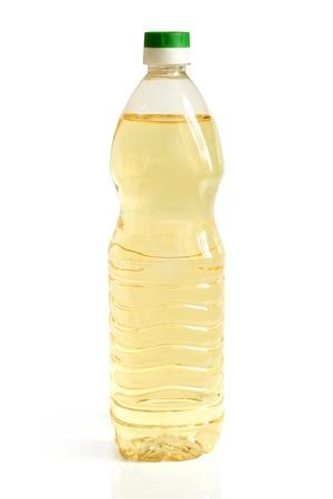 Vegetable oil in plastic bottle on a white background Stock Photo - 14072106