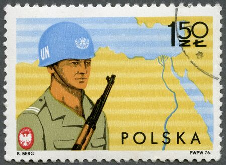 un used: POLAND - CIRCA 1976: A stamp printed in Poland shows Soldier and Map of Sinai, Polish specialist troops serving with UN Forces in Sinai Peninsula, circa 1976