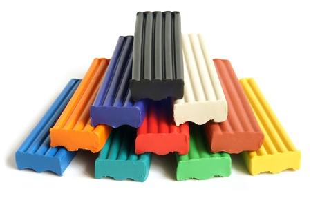 Color children's plasticine on a white background Stock Photo - 14172539