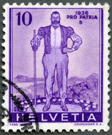 SWITZERLAND - CIRCA 1936: A stamp printed in Switzerland, shows Alpine Herdsman, circa 1936 Stock Photo - 14172652