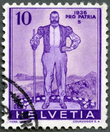 herdsman: SWITZERLAND - CIRCA 1936: A stamp printed in Switzerland, shows Alpine Herdsman, circa 1936