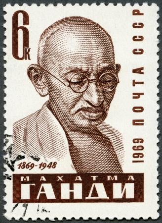 USSR - CIRCA 1969: A stamp printed in USSR shows portrait of Mohandas Karamchand Gandhi (1869-1948), circa 1969 photo