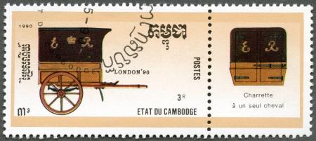 CAMBODIA - CIRCA 1990: A stamp printed in Cambodia, dedicated STAMPWORLD LONDON-90, shows mail coach, circa 1990 photo