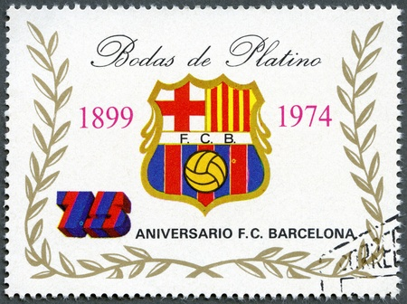stamp collecting: EQUATORIAL GUINEA - CIRCA 1974: A stamp printed in Equatorial Guinea shows label of Barcelona Soccer Team, 75th anniversary, circa 1974