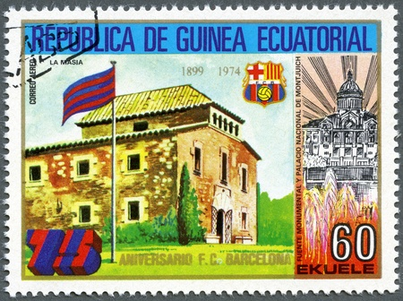 EQUATORIAL GUINEA - CIRCA 1974: A stamp printed in Equatorial Guinea shows La Masia, Barcelona Soccer Team, 75th anniversary, circa 1974 photo