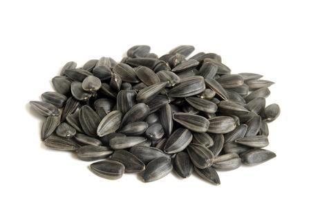 semillas de girasol: Las semillas de girasol sobre un fondo blanco