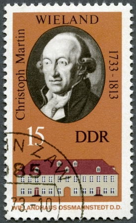 GERMANY - CIRCA 1973: A stamp printed in Germany shows Christoph Martin Wieland (1733-1813) and his Home in Ossmannstedt, circa 1973 Stock Photo - 14242789