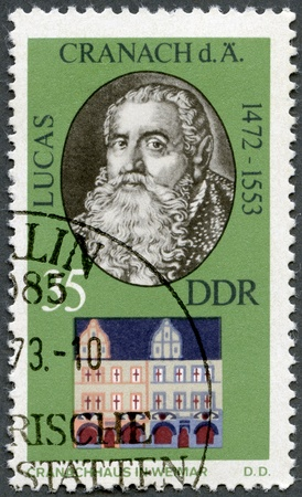 GERMANY - CIRCA 1973: A stamp printed in Germany shows Lucas Cranach the Elder (1472-1553) and his Home in Weimar, circa 1973 Stock Photo - 14242792