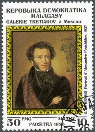 alexander: MALAGASY REPUBLIC - CIRCA 1986: A stamp printed in Malagasy (Madagascar) shows Portrait of Alexander Pushkin, 1827, by O. Kiprensky, series Paintings in the Tretyakov Gallery, Moscow, circa 1986