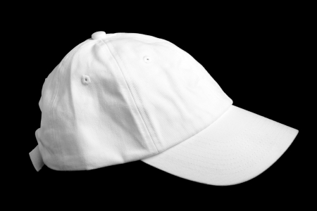 White baseball cap isolated on black background photo