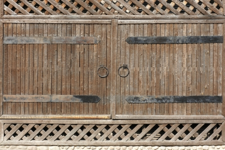 iron cross: Wooden gate with metal handle, a horizontal picture