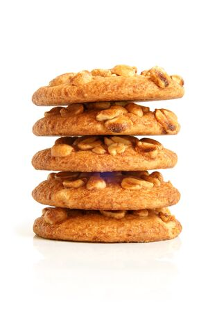baked goods: Stack of sugar cookies with peanuts on a white background