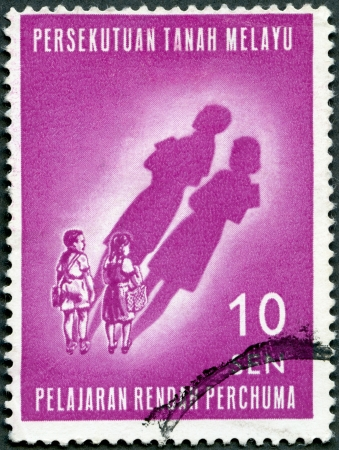 malaya: MALAYA - CIRCA 1962: A stamp printed by Malaya shows Children and their Future Shadows, Free primary education introduced January 1962, circa 1962