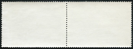 Blank postage stamp block on a black background photo