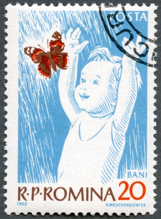 ROMANIA - CIRCA 1962: A stamp printed in Romania shows Child and Butterfly, circa 1962