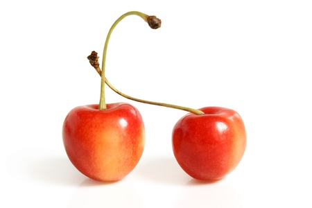 ripeness: Two cherries on a white background