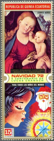 EQUATORIAL GUINEA - CIRCA 1972: A stamp printed in Equatorial Guinea shows Madonna and Christmas, is devoted 500th Birth Anniversary Lucas Cranach the Elder, circa 1972 photo