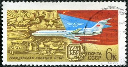 USSR - CIRCA 1973: A stamp printed in USSR shows TU-154 Turbojet Passenger Plane, 50th anniversary of Soviet Civil Aviation, circa 1973 Stock Photo - 14581365