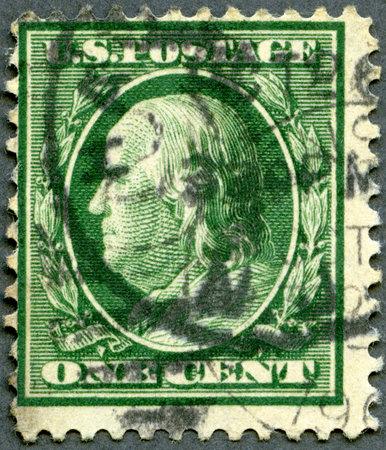 satirist: USA - CIRCA 1908: A stamp printed in USA shows portrait of Benjamin Franklin (1706-1790), circa 1908