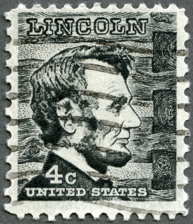 assassinated: USA - CIRCA 1965: A stamp printed in USA shows President Abraham Lincoln (1809-1865), series Prominent Americans Issue, circa 1965