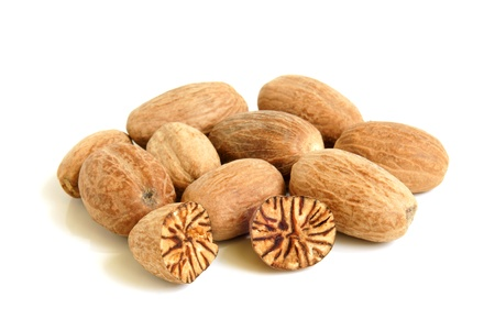 mace: Nutmeg on a white background Stock Photo