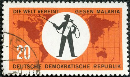 eradicate: GERMANY - CIRCA 1963: A stamp printed in Germany shows World Map and Exterminator, series