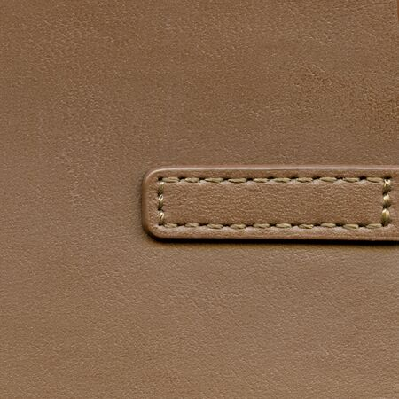 Natural brown leather background closeup photo