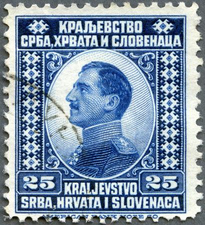 yugoslavia: YUGOSLAVIA - CIRCA 1921: A stamp printed in Yugoslavia shows king Alexander I of Yugoslavia, circa 1921 Editorial