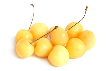 ripeness: Yellow cherries on a white background Stock Photo