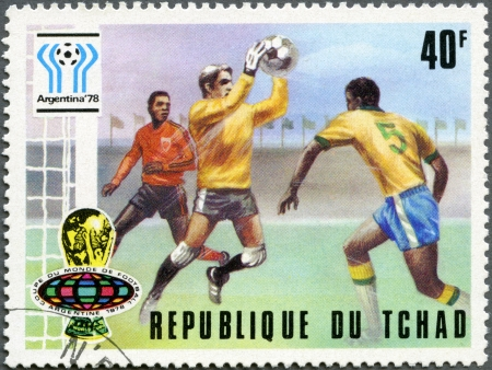 CHAD - CIRCA 1977: A stamp printed in Chad shows World Cup Emblems and Saving a Goal, devoted World Cup Soccer Championship, Argentina 1978, circa 1977