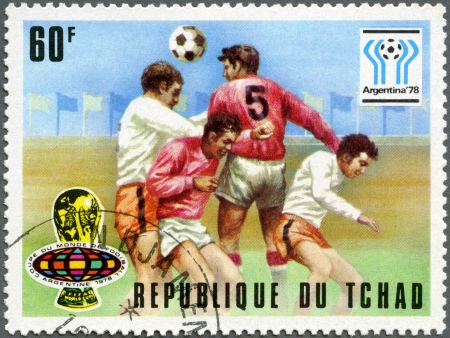 CHAD - CIRCA 1977: A stamp printed in Chad shows World Cup Emblems and Heading the ball, devoted World Cup Soccer Championship, Argentina 1978, circa 1977