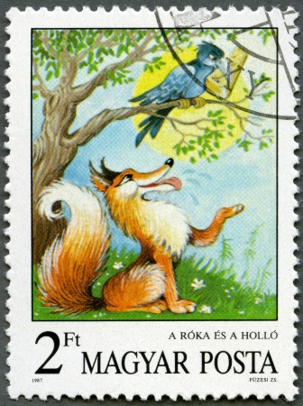 crows: HUNGARY - CIRCA 1987: A stamp printed by Hungary shows the Fox and the Crow, Aesop's Fables, Fairy Tales series, circa 1987 Stock Photo