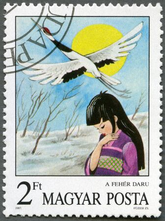 HUNGARY - CIRCA 1987: A stamp printed by Hungary shows the White Crane, from Japan, Fairy Tales series, circa 1987 photo