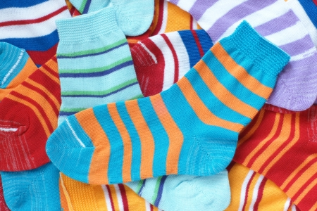child's: Many pairs of childs striped socks, for backgrounds or textures Stock Photo