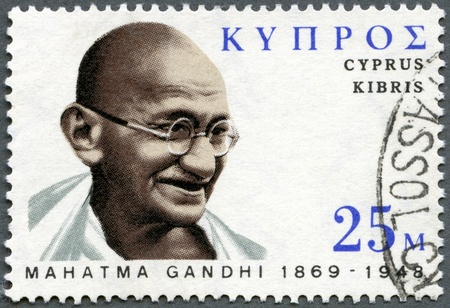 ideological: CYPRUS - CIRCA 1970: A stamp printed in Cyprus shows portrait of Mohandas Karamchand Gandhi (1869-1948), birth centenary, leader in Indias struggle for independence, circa 1970 Editorial