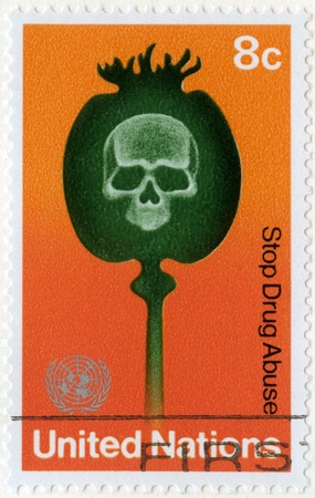 narcotism: UNITED NATIONS, OFFICES IN NEW YORK - CIRCA 1973: A stamp printed UN, shows Poppy Capsule and Skull, Stop Drug Abuse, circa 1973