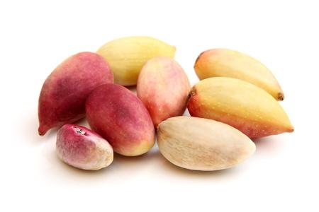 Fresh pistachios on a white background photo