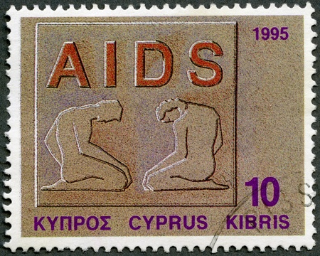 aids symbol: CYPRUS - CIRCA 1995: A stamp printed in Cyprus shows Fight against AIDS, series Health, circa 1995