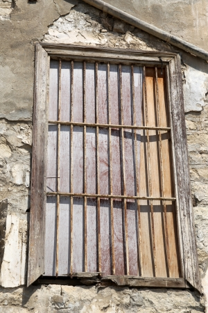 fractured: Old locked window with lattice in vintage wall, a vertical picture Stock Photo