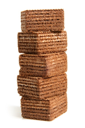 knurled: Stack of chocolate wafers on a white background